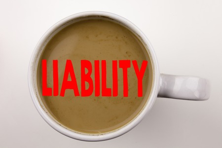 Word, writing Liability text in coffee in cup. Business concept for Accountability Legal Blame Risk on white background with space. Black text with red word.
