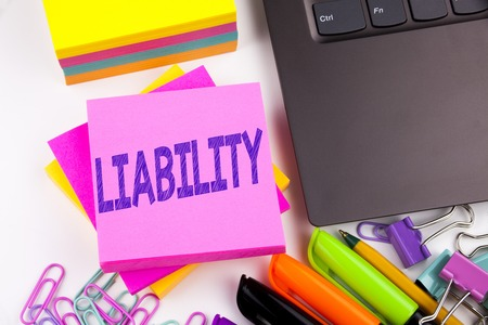Writing text showing Liability made in the office with surroundings such as laptop, marker, pen. Business concept for Accountability Legal Blame Risk Workshop white background space 스톡 콘텐츠