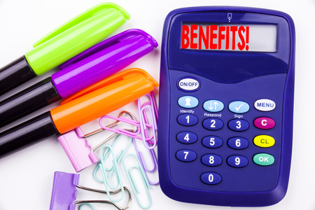 Writing word Benefits text in the office with surroundings marker, pen writing on calculator. Business concept for Bonus Employee Financial Benefits white background with space