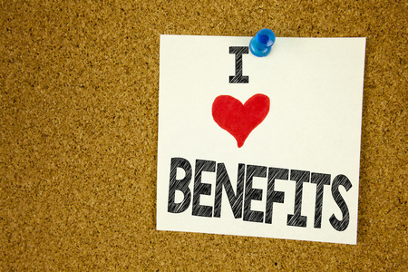 Hand writing text caption inspiration showing I Love Benefits concept meaning Bonus Employee Financial Benefits Loving written on sticky note, reminder isolated background with space Archivio Fotografico