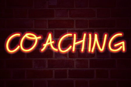 Coaching neon sign on brick wall background. Fluorescent Neon tube Sign on brickwork Business concept for Personal Training Mentoring 3D rendered Front View Stock Photo