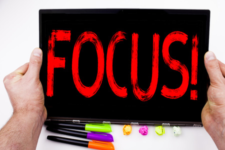 Focus text written on tablet, computer in the office with marker, pen, stationery. Business concept for Attention Success Concentrate white background with space Stock Photo