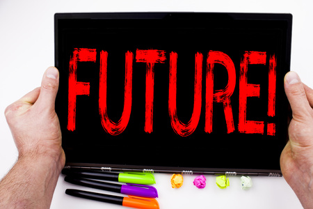Future text written on tablet, computer in the office with marker, pen, stationery. Business concept for The Time That Is To Come Beginning From Now white background with space
