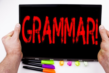 Grammar text written on tablet, computer in the office with marker, pen, stationery. Business concept for  The Basic Rules of Syntax Grammatical Language white background with space Stock Photo