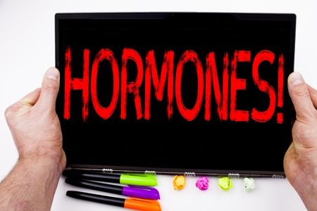 Hormones text written on tablet, computer in the office with marker, pen, stationery. Business concept for Hormone Pill white background with space