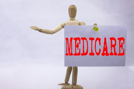 Conceptual hand writing text caption inspiration showing Medicare Business concept for Comprehensive Medical Insurance Health Plan written sticky note sculpture background with space Stock Photo