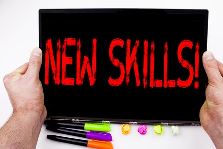 New Skills text written on tablet, computer in the office with marker, pen, stationery. Business concept for Education Knowledge Development white background with space