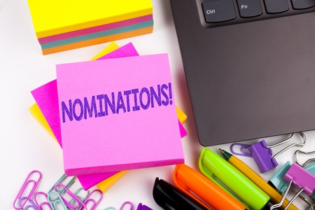 Writing text showing Nominations made in the office with surroundings such as laptop, marker, pen. Business concept for Election Nominate Nomination Workshop white background space Stockfoto - 91531360