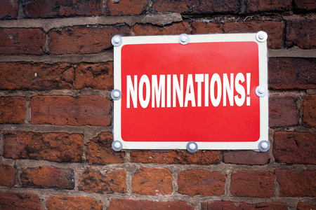 Hand writing text caption inspiration showing Nominations concept meaning Election Nominate Nomination written on old announcement road sign with background and space