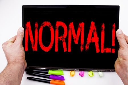 Normal text written on tablet, computer in the office with marker, pen, stationery. Business concept for Confidence Abnormal Normality Problem Issue white background with space Stock Photo