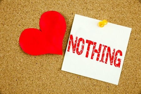 Conceptual hand writing text caption inspiration showing Nothing concept for Contradiction Nothing Rejection and Love written on sticky note, reminder cork background with space Stock Photo