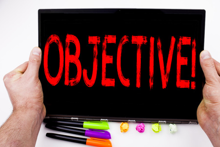 Objective text written on tablet, computer in the office with marker, pen, stationery. Business concept for Unbiased Neutral Detached Factual Judicial white background with space