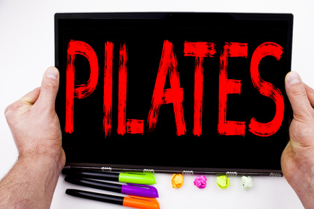Pilates text written on tablet, computer in the office with marker, pen, stationery. Business concept for Fitness Balance Workout Exercise white background with space Stock Photo
