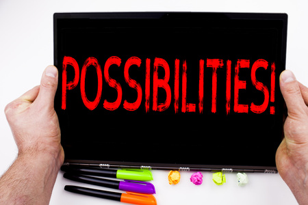 Possibilities text written on tablet, computer in the office with marker, pen, stationery. Business concept for Impossible Choice Choices white background with space