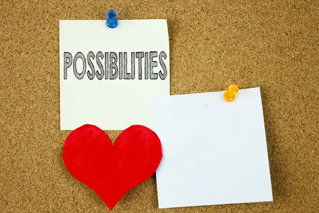 Conceptual hand writing text caption inspiration showing Possibilities concept for Impossible Choice Choices and Love written on sticky note, cork background with copy space Stock Photo