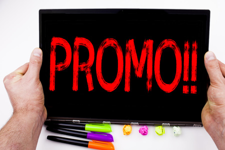 Promo text written on tablet, computer in the office with marker, pen, stationery. Business concept for Promo Sale Shopping Product Promotion white background with space