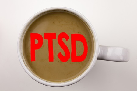 Word, writing PTSD Post-Traumatic Stress Disorder  text in coffee in cup. Business concept for Health Treatment on white background with space. Black text with red word.