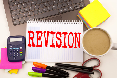 Word writing Revision in the office with  laptop, marker, pen, stationery, coffee. Business concept for Repeat Repetition Education Material for Exam Workshop white background with space