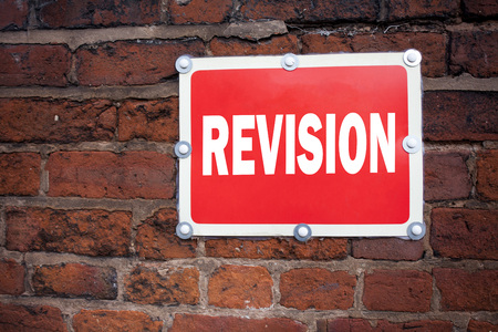 Hand writing text caption inspiration showing Revision concept meaning Repeat Repetition Education Material for Exam written on old announcement road sign with background and space