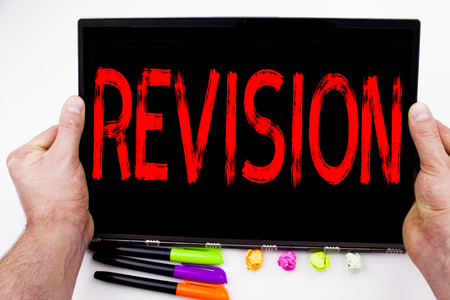 Revision text written on tablet, computer in the office with marker, pen, stationery. Business concept for Repeat Repetition Education Material for Exam white background with space Archivio Fotografico