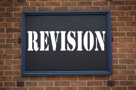 Conceptual hand writing text caption showing announcement Revision. Business concept for  Repeat Repetition Education Material for Exam written on frame old brick background with space Stock Photo