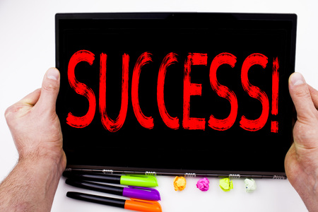Success text written on tablet, computer in the office with marker, pen, stationery. Business concept for Victory Triumph Good Result Favourable Outcome white background with space
