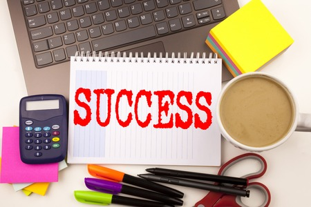 Word writing Success in the office with  laptop, marker, pen, stationery, coffee. Business concept for Victory Triumph Good Result Favourable Outcome Workshop white background with space Stock Photo