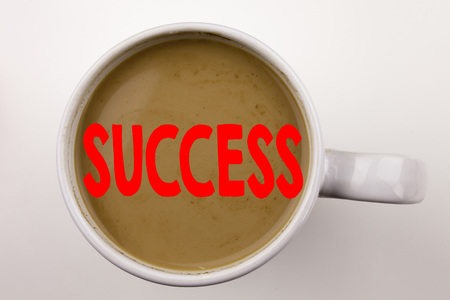 Word, writing Success text in coffee in cup. Business concept for Victory Triumph Good Result Favourable Outcome on white background with space. Black text with red word.