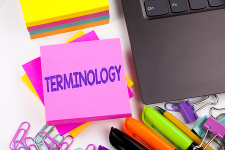 Writing text showing Terminology made in the office with surroundings such as laptop, marker, pen. Business concept for Medical Legalistic Terminological Workshop white background space Stock Photo