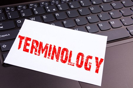 Writing Terminology text made in the office close-up on laptop computer keyboard. Business concept for Medical Legalistic Terminological Workshop on the black background with space