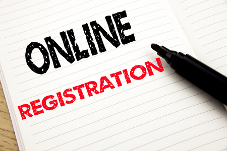Online Registration. Business concept for Internet Login written on notebook with space on book background with marker pen