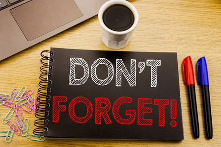 Handwriting Announcement text showing Do Not Forget. Business concept for Reminder Message written on notebook book on wooden background in the Office with laptop coffee
