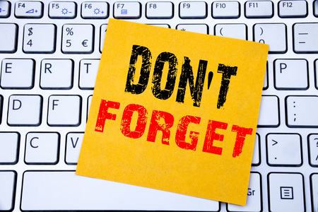Do Not Forget. Business concept for Reminder Message written on sticky note paper on white keyboard background.