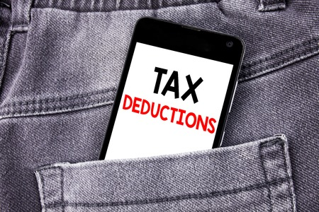 Conceptual hand writing text caption showing Tax Deductions. Business concept for Finance Incoming Tax Money Deduction written mobile cell phone with space in the back pants trousers pocket Stock Photo - 95107104