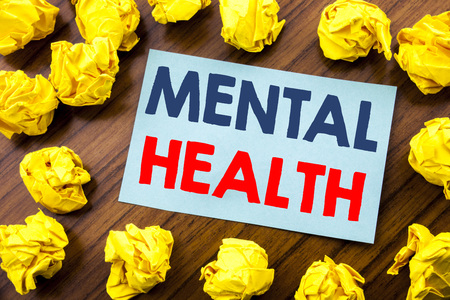 Conceptual hand writing text inspiration showing Mental Health. Business concept for Anxiety Illness Disorder written on sticky note paper the wooden background with folded yellow paper