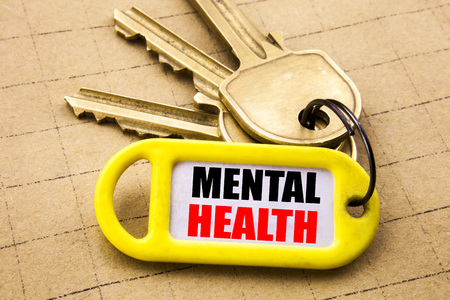 Word, writing Mental Health. Business concept for Anxiety Illness Disorder Written on key holder, close up.