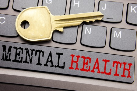 Hand writing text caption inspiration showing Mental Health. Business concept for Anxiety Illness Disorder written on keyboard key on the key next to the text.