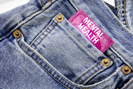 Handwriting Announcement text showing Mental Health. Business concept for Anxiety Illness Disorder Written on condom pack put in small pocket to pants jeans.