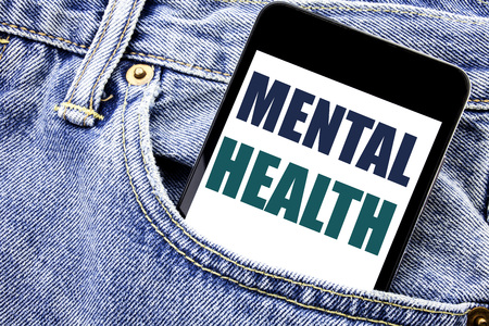 Conceptual hand writing text caption inspiration showing Mental Health. Business concept for Anxiety Illness Disorder Written phone mobile phone, cellphone placed in man front jeans pocket. 写真素材