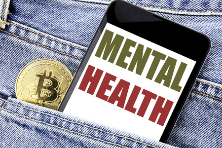 Conceptual hand writing text caption inspiration showing Mental Health. Business concept for Anxiety Illness Disorder Written phone mobile phone, cellphone placed in man front jeans pocket. Stock Photo