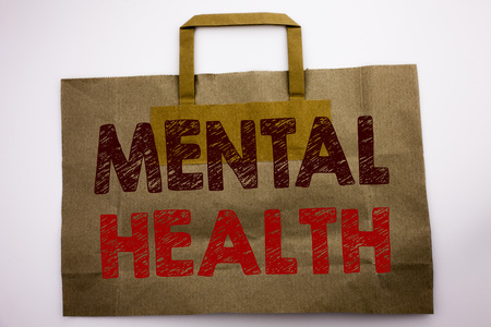 Word, writing Mental Health. Business concept for Anxiety Illness Disorder Written shopping bag, white isolated background.