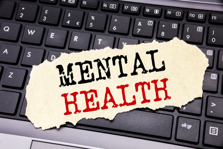 Writing text showing Mental Health. Business concept for Anxiety Illness Disorder written on sticky note paper on black keyboard background.