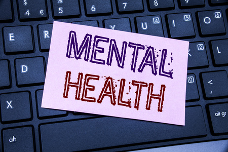 Handwriting Announcement text showing Mental Health. Business concept for Anxiety Illness Disorder written on sticky note paper on black keyboard background. 写真素材