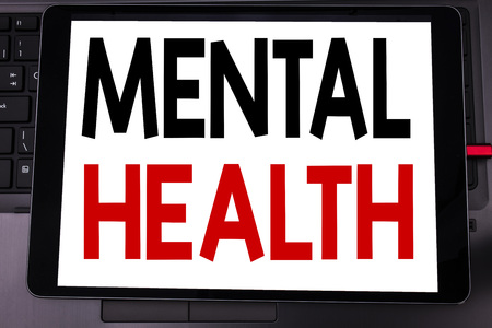 Conceptual hand writing text caption inspiration showing Mental Health. Business concept for Anxiety Illness Disorder written on tablet laptop on black keyboard background.
