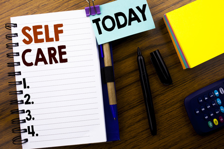 Word, writing Self Care. Business concept for Taking caring for own Health written on book note paper on wooden background. With attached today sign. Office top view. Stock Photo - 95540275