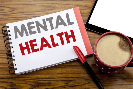 Handwriting Announcement text showing Mental Health. Business concept for Anxiety Illness Disorder Written on notepad paper on wooden background with space office view with pencil marker