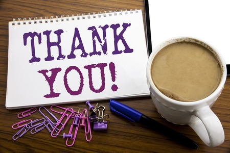 Hand writing text caption inspiration showing Thank You. Business concept for Thanks Message written on note paper on wooden background with coffee and pen
