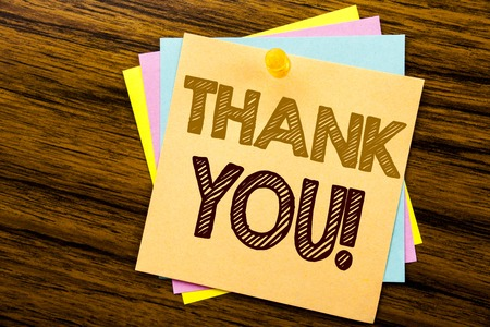 Conceptual hand writing text caption inspiration showing Thank You. Business concept for Thanks Message written on sticky note paper on wooden background.