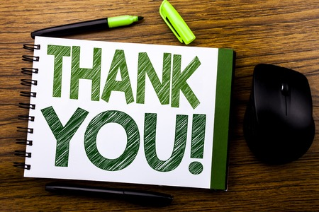 Handwriting Announcement text showing Thank You. Business concept for Thanks Message written on notebook book note paper on wooden background. Green word letters. Next to mouse.
