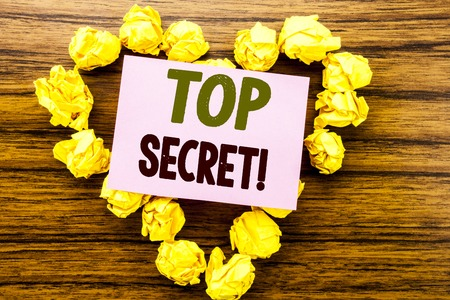 Word, writing Top Secret. Business concept for Military Top Secret written on sticky note paper on wooden background.